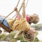 Siblings Swinging